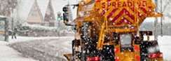 A gritter goes out gritting on the street