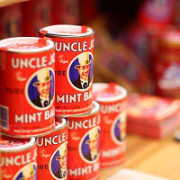 Stack of tins of Uncle Joe's mint balls on a shelf
